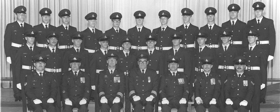 Slide - MWO (Ret) Roger Leroux sitting with his Canadian Forces recruit class of 1977.